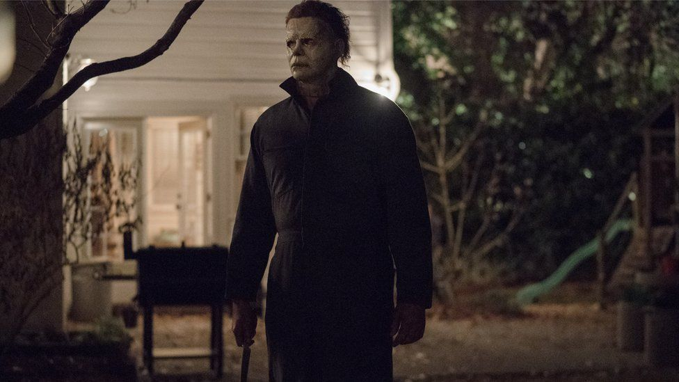 Michael Myers is pictured holding a long knife by his side