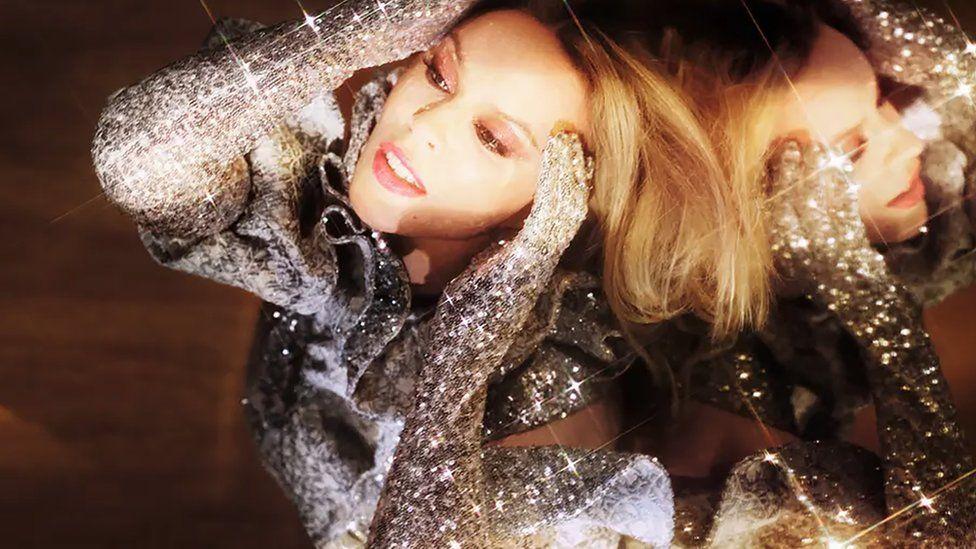 Kylie Minogue poses in the Swarovski-embellished Alistair James top