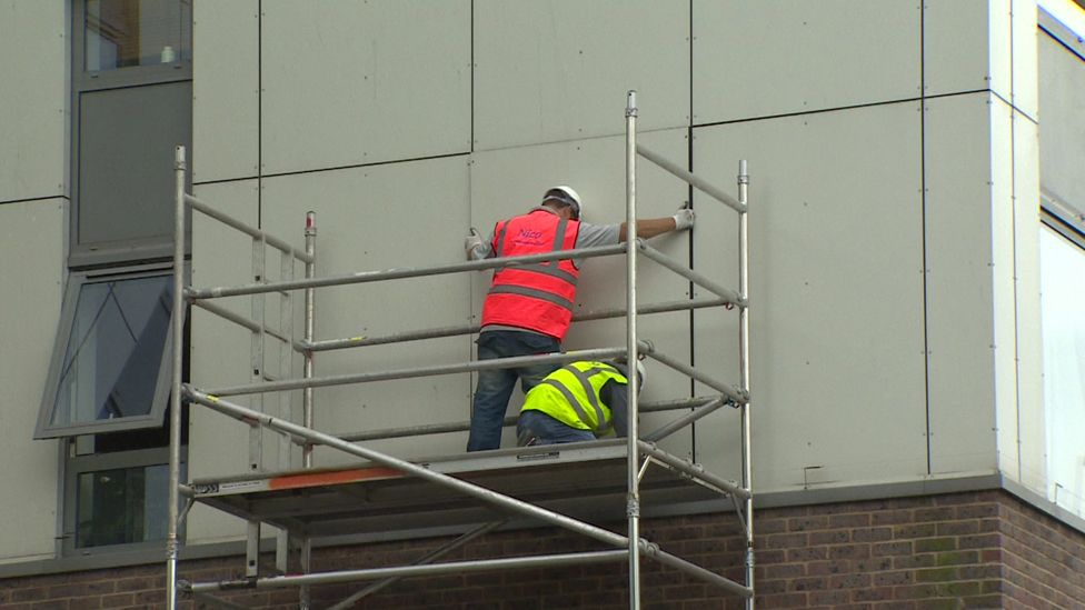 Cladding being removed