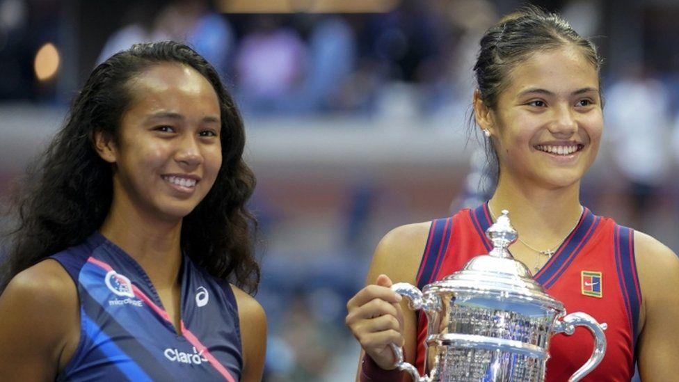 "Great Britain""s Emma Raducanu holds the trophy as she celebrates winning the women""s singles final alongside runner up Canada""s Leylah Fernandez"