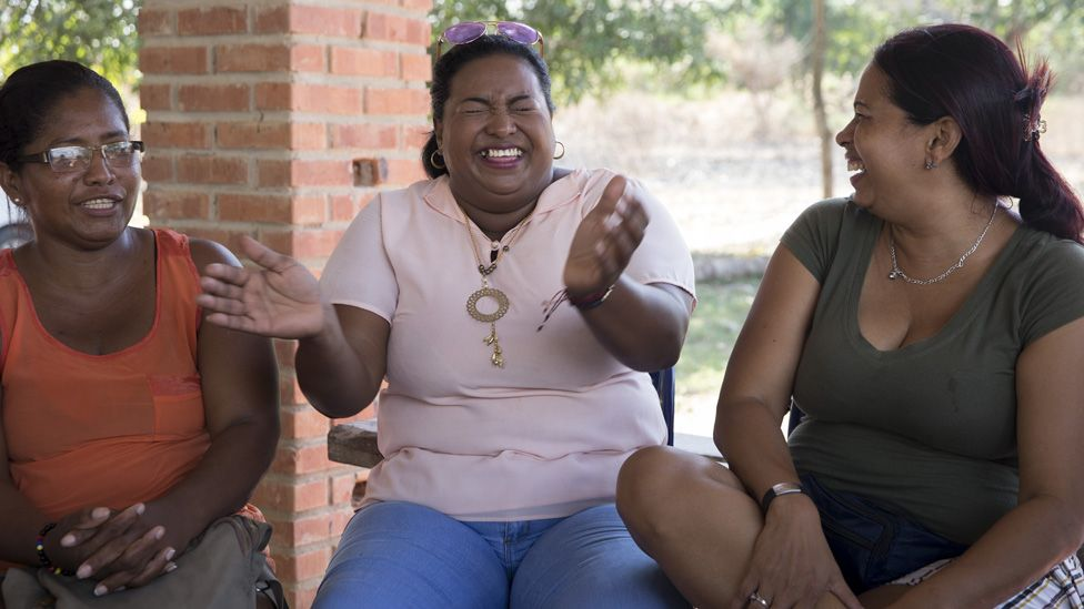 Erika Maria Gamarra Caro, 42, (centre) laughs during a meeting with other members of the League of Displaced Women.