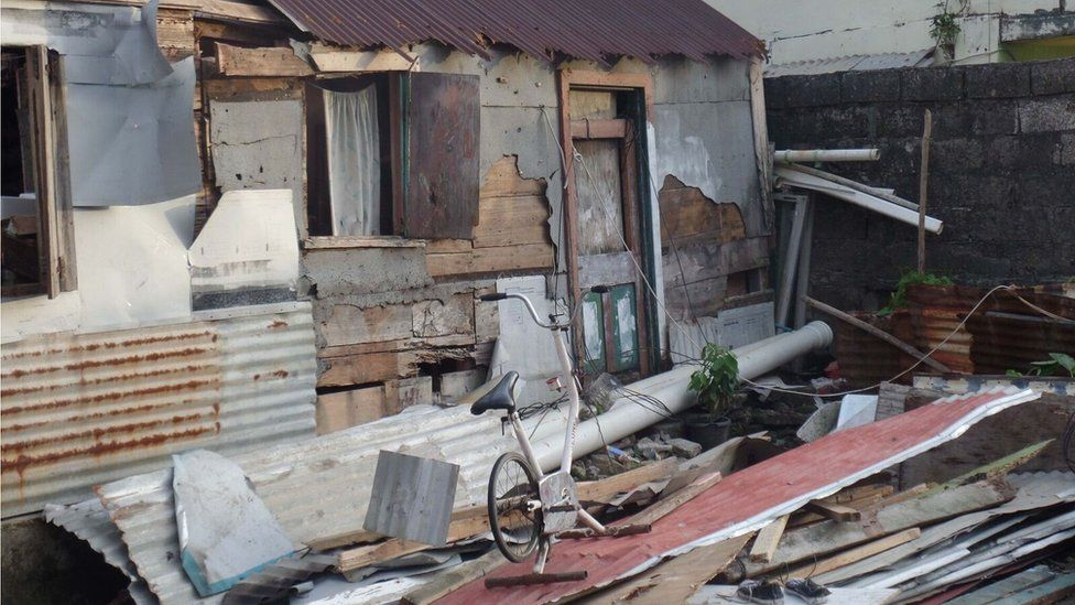 An exercise bike is the only thing left sanding in this destroyed home in Soufriere.