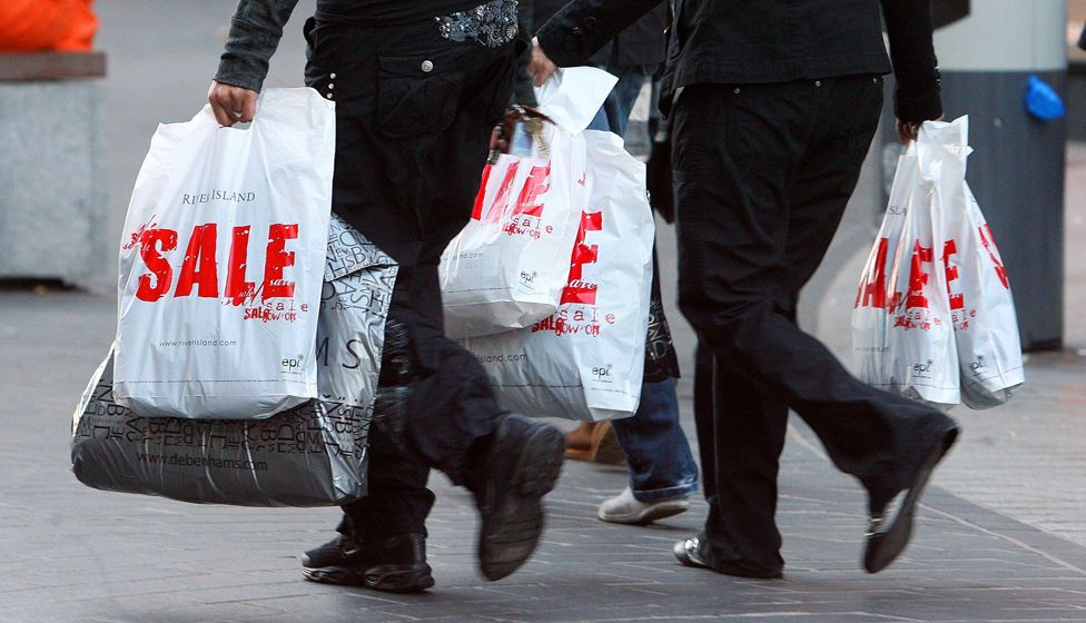 People carrying sale bags