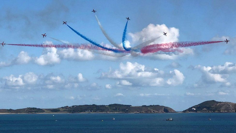 Red Arrows with Herm in the background