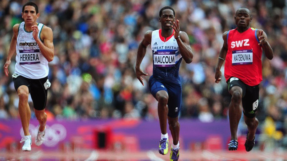 Swaziland's Sibusiso Matsenjwa (right) runs against competitors from Mexico and Great Britain at the London 2012 Olympic Games, 7 August 2012
