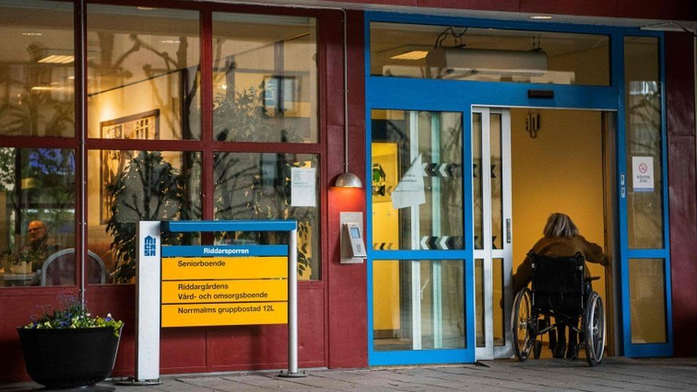 A woman entering her nursing home in Sweden