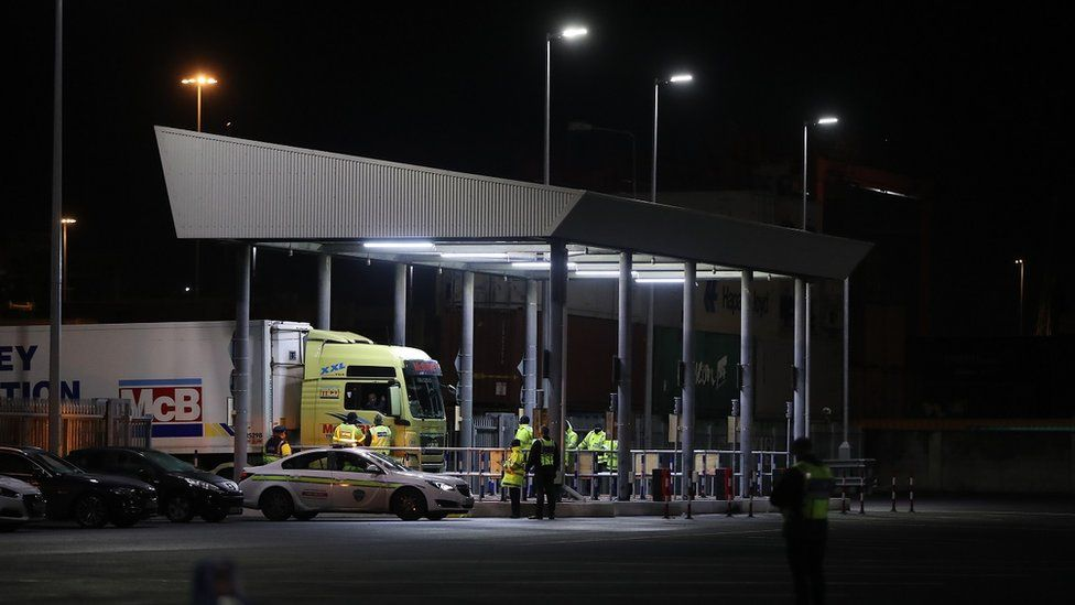 Trucks pass through a customs post at Dublin Port