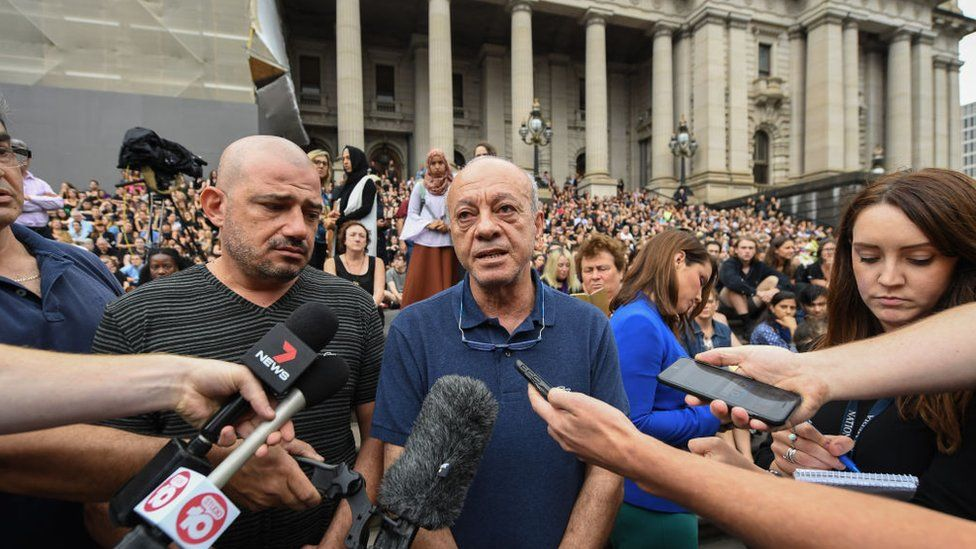 Ms Maasarwe's father Saeed in front of thousands of people at a vigil in central Melbourne in January