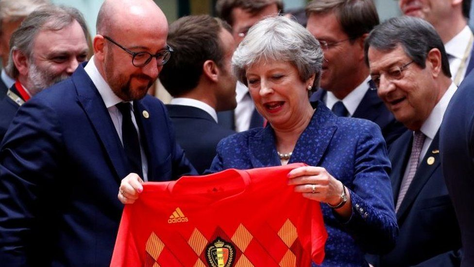 """Theresa May receives Belgium""""s national soccer team jersey from Belgian Prime Minister Charles Michel"""