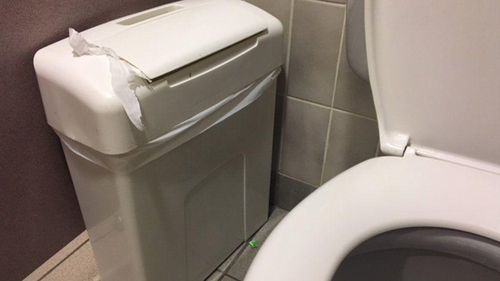 sanitary bin in toilet