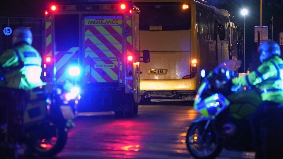 An ambulance and police are seen outside Arrowe Park hospital