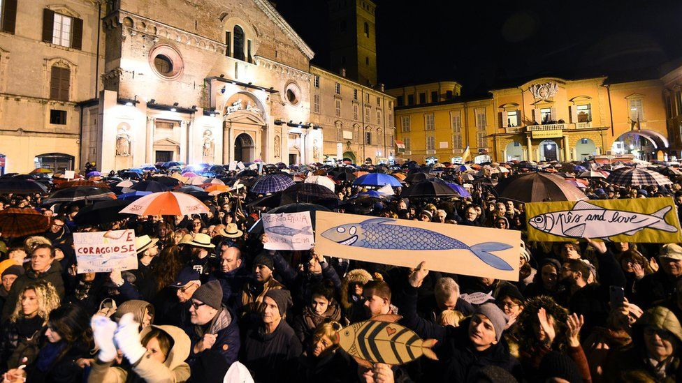 "Protesters attend a demonstration held by the ""Sardines"", a grassroots movement against far-right League leader Matteo Salvini, in Reggio Emilia, Italy, 23 November 2019"
