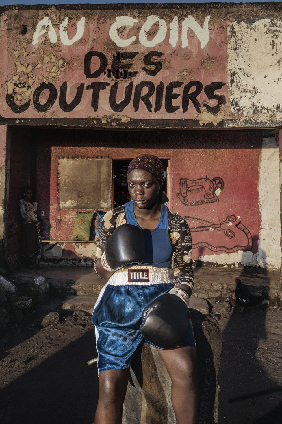 Ester, 16 years old, portrayed on the streets of Goma. She is part of the Club Virunga, one of the two official boxing clubs in Goma.
