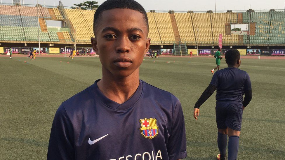 Somagbe Ipedumi from Ikorodu, is a recruit of the Barcelona Academy in Lagos, stands on the pitch.