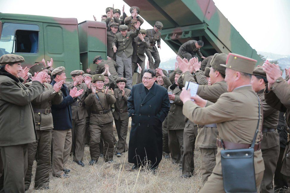 """An undated photograph made available on 4 March 2016 by the North Korean news agency KCNA showing Kim Jong Un, supreme commander of the Korean People""""s Army, meeting millitary personnel during the test-firing of new-type large-caliber multiple launch rocket system"""