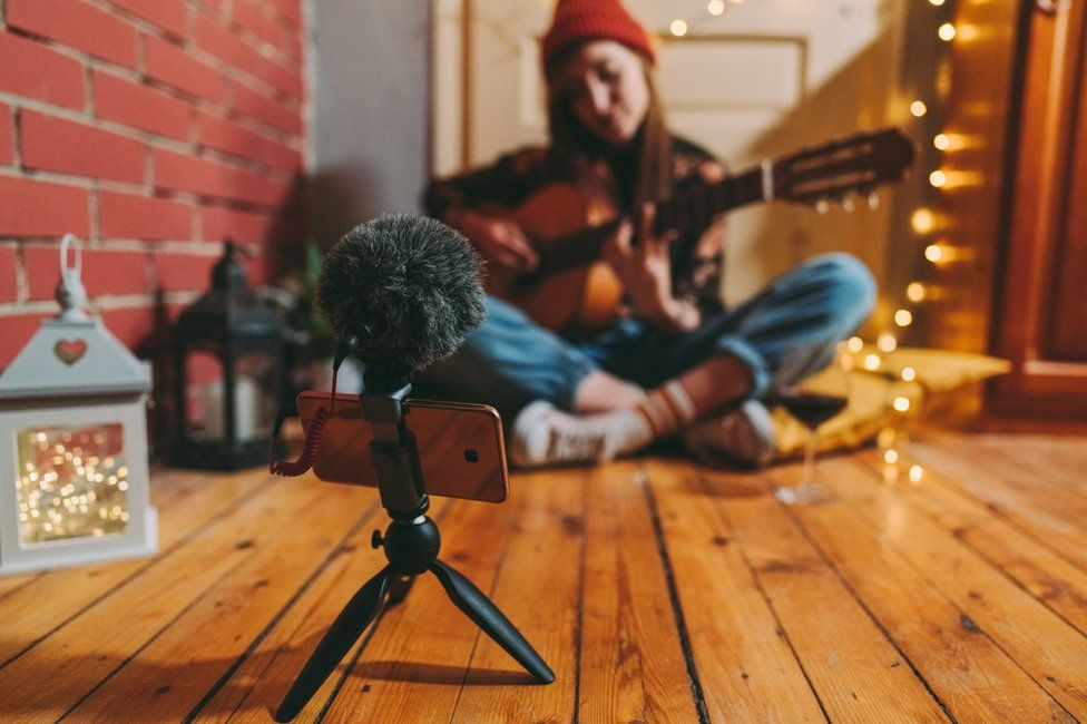 A musician recording at home