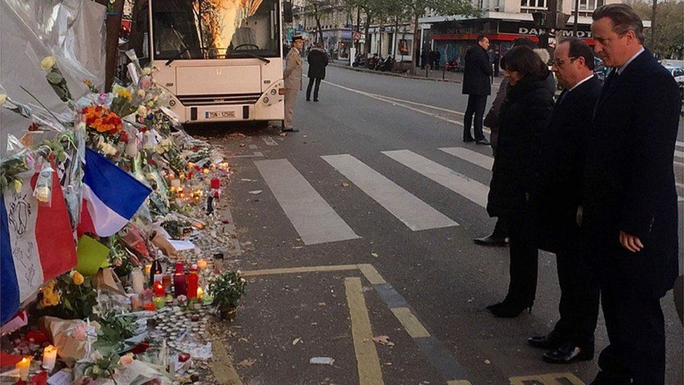 David Cameron with French President Francois Hollande outside the Bataclan