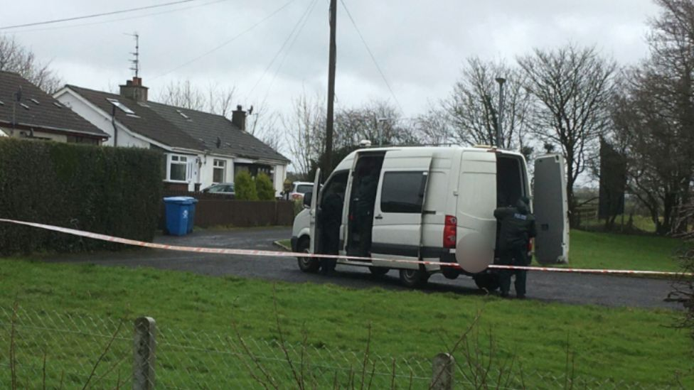 A police van at the scene of the attack at Mosside Gardens
