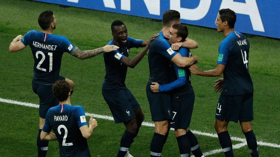France's Antoine Griezmann (C) celebrates with teammates after scoring a goal during the Russia 2018 World Cup final football match, 15 July 2018