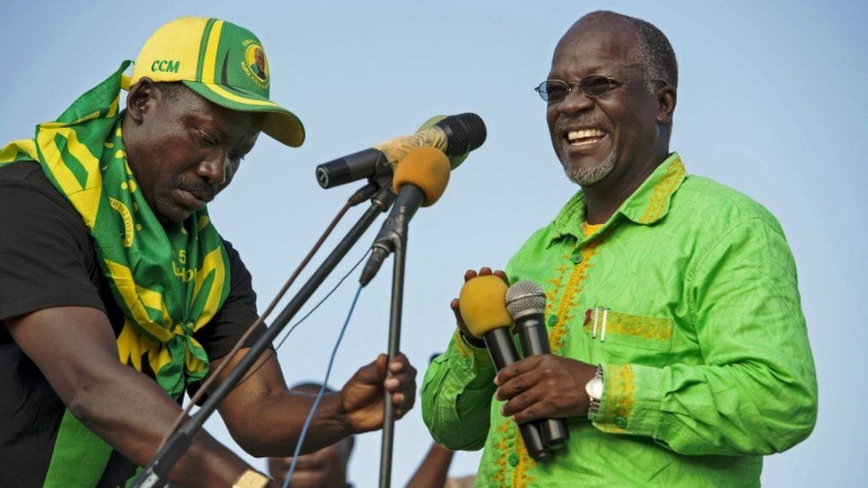 Presidential candidate John Magufuli laughs as microphones are set up during a ruling Chama Cha Mapinduzi (CCM) rally in Dar es Salaam, Tanzania, on October 21, 2015