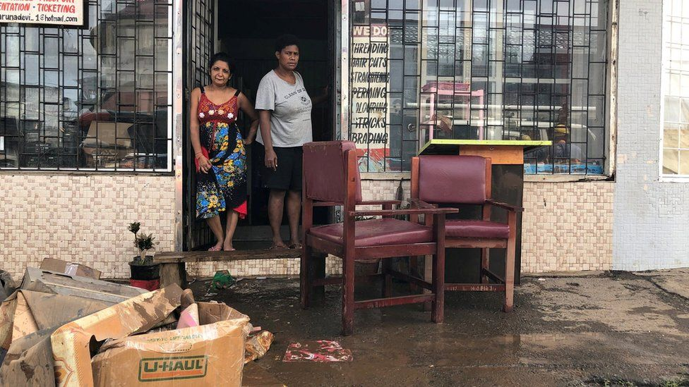 Business owners at their property after flooding from Tropical Cyclone Josie in Fiji
