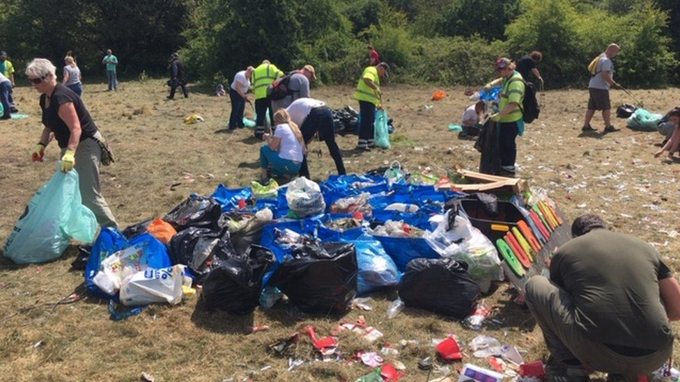 Volunteers clear bags of rubbish from the Daisy nook site