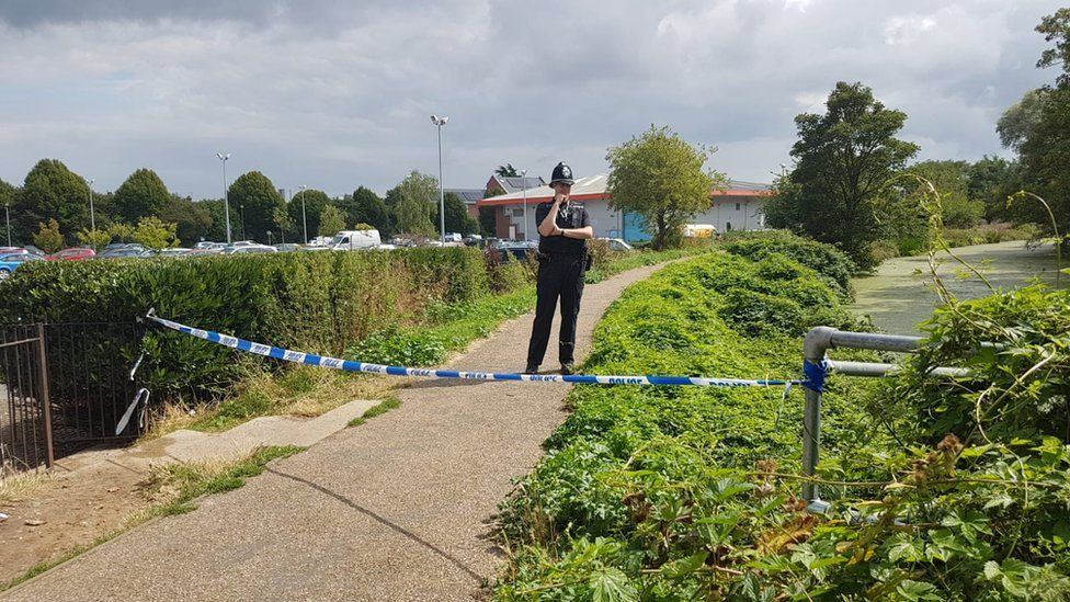 The police cordon near the River Gipping behind Suffolk Retail Park in Ipswich