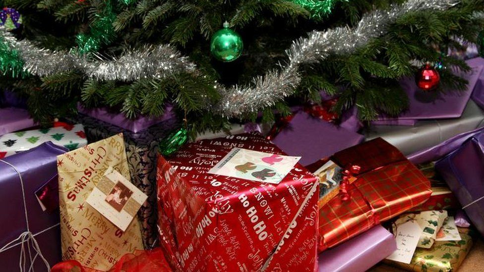 Wrapped presents under a Christmas tree