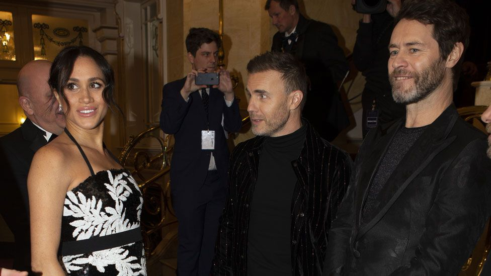 Meghan with members of Take That
