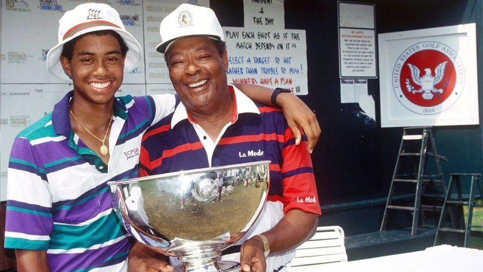 Tiger Woods with his father after he won the USGA Junior Amateur Championships in Orlando in July 1991