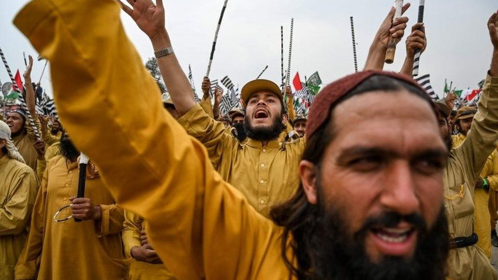 "Activists and supporters of Islamic political party Jamiat Ulema-e-Islam (JUI-F) shout slogans during an anti-government ""Azadi (Freedom) March"" in Islamabad on November 1, 2019"