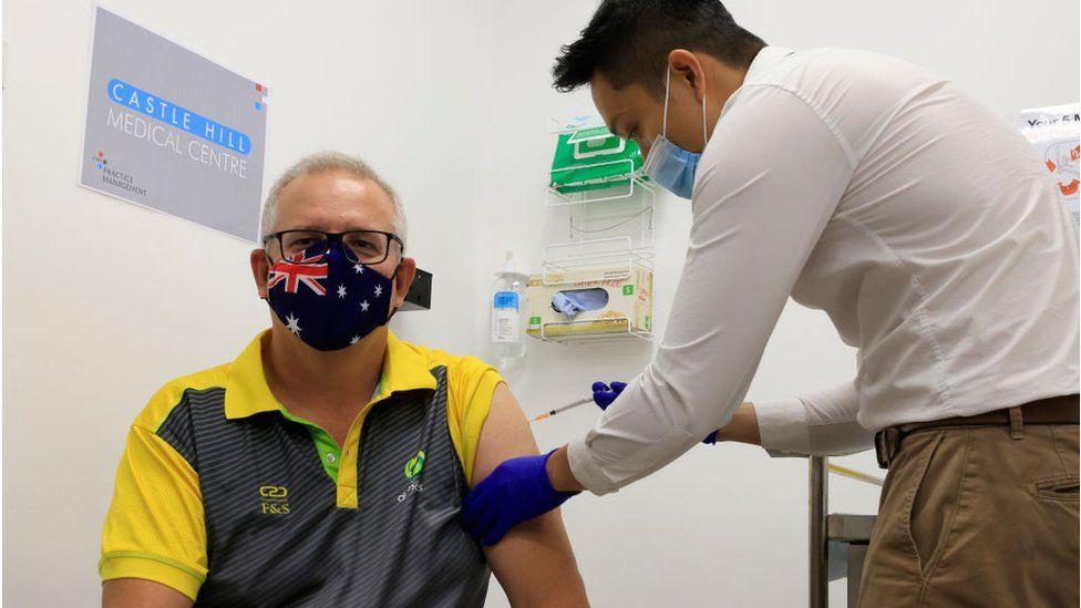 Australian Prime Minister Scott Morrison receives a Covid-19 vaccination