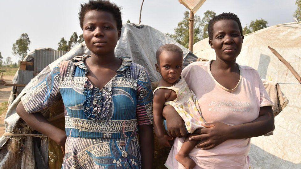 Two women with children in camp in Burundi