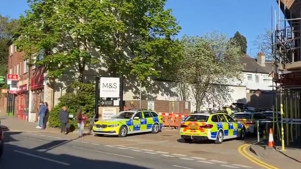 A cordon is in place behind Marks and Spencer and the car park is closed