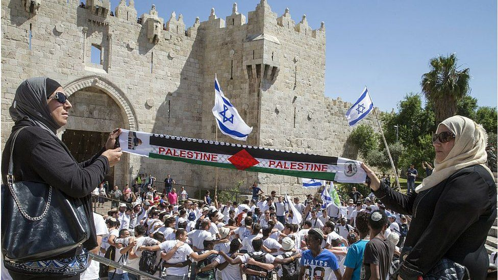 "Israeli flags and a ""Palestine"" scarf, Jerusalem (file photo)"