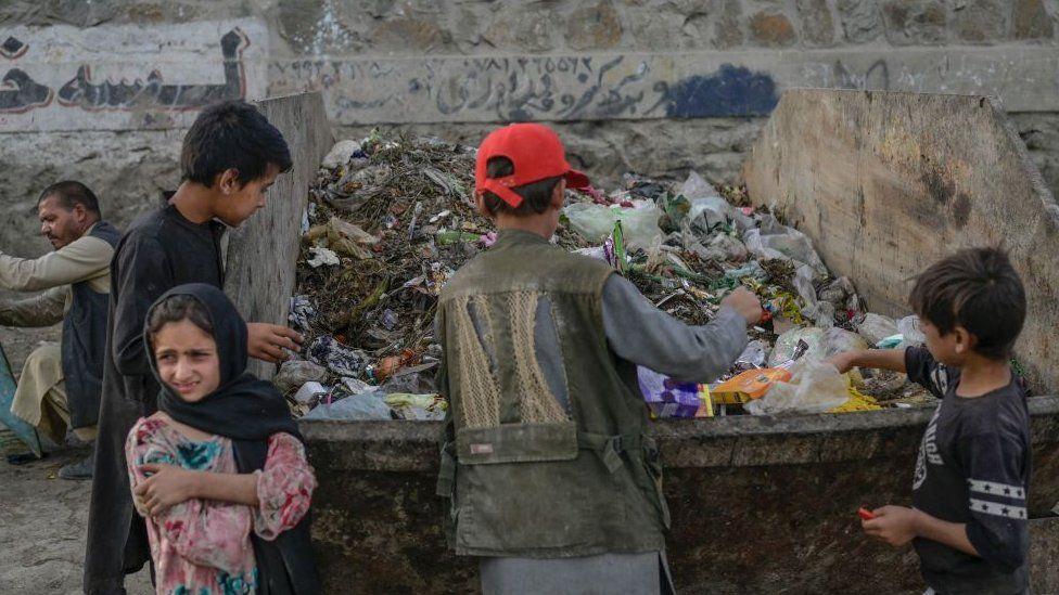 Children looking in rubbish bins near Kabul airport - September 2021
