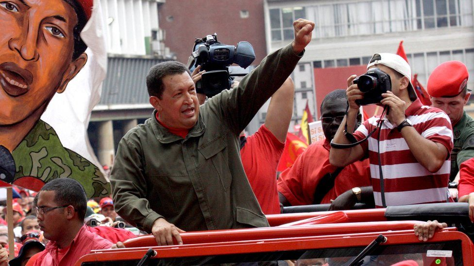 Late Venezuelan president Hugo Chavez gestures to supporters as he arrives to campaign in Caracas on 23 January 2009
