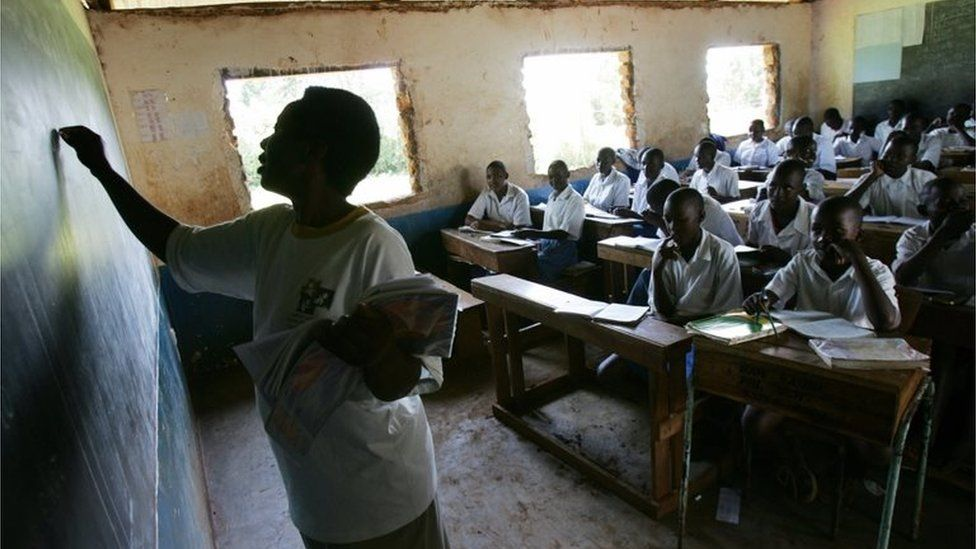 A teacher writes on a blackboard during a class at the Bar Sauri elementary school in eastern Kenya 22 March 2007.