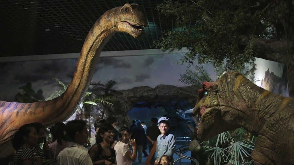North Koreans look at models of dinosaurs at the Natural History Museum, part of the newly opened Pyongyang Central Zoo in Pyongyang, North Korea, Tuesday, Aug. 23, 2016.