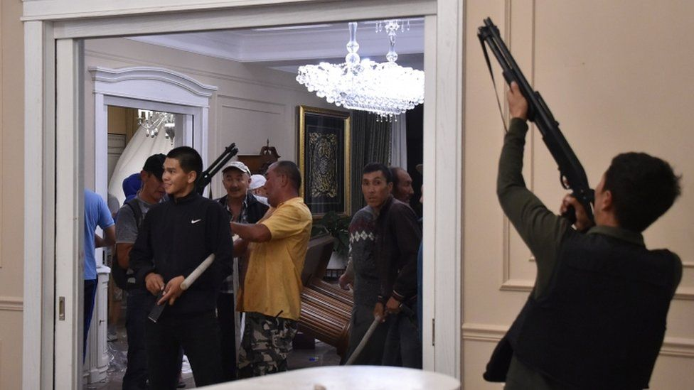 Supporters of former president Almazbek Atambayev guard his house as members of the special forces try to detain him outside the capital Bishkek on August 7, 2019