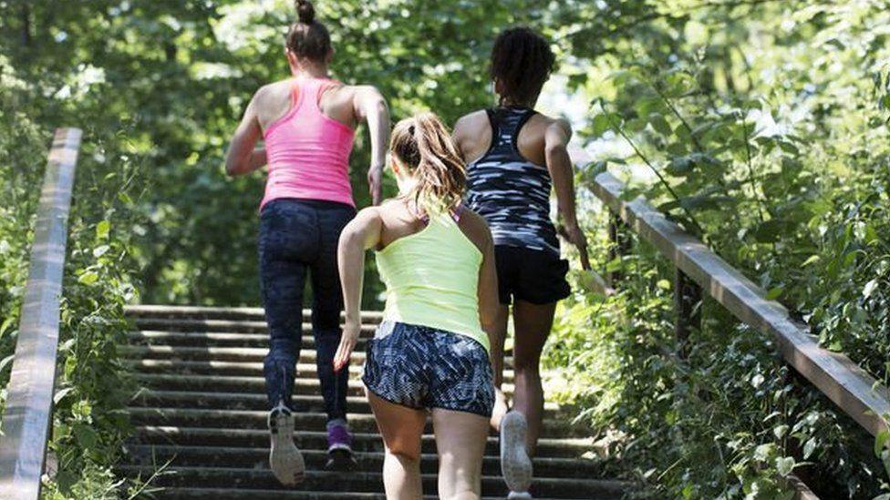 Women take part in a Mom In Balance back in shape class