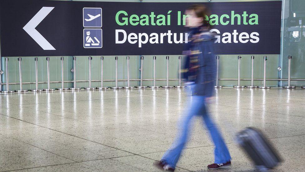 A traveller walks toward the departure gate at Dublin Airport