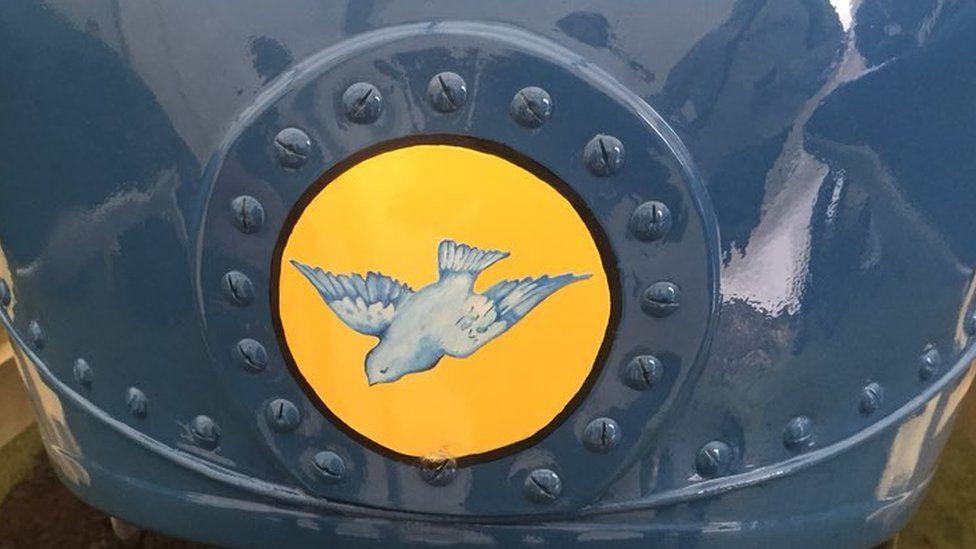 bluebird emblem on front of hyrdoplane
