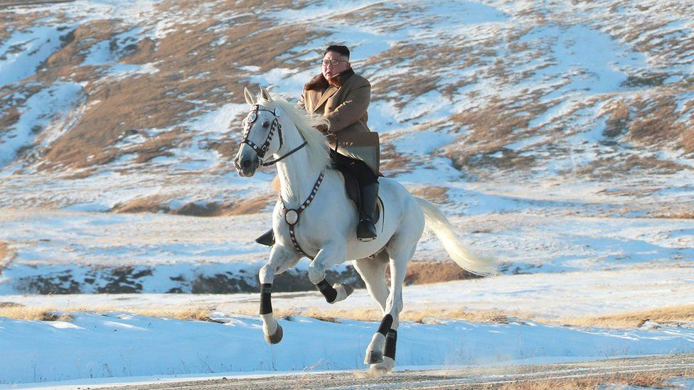 This undated picture released by Korean Central News Agency on October 16, 2019 shows North Korean leader Kim Jong Un riding a white horse amongst the first snow at Mouth Paektu.