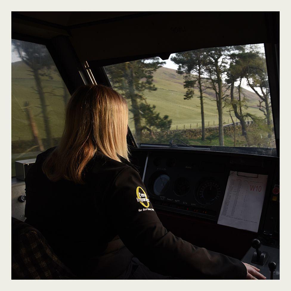 Heather Waugh drives a Class 90 locomotive through lowland Scotland