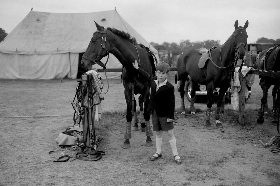Prince Charles giving a friendly pat to one of the ponies