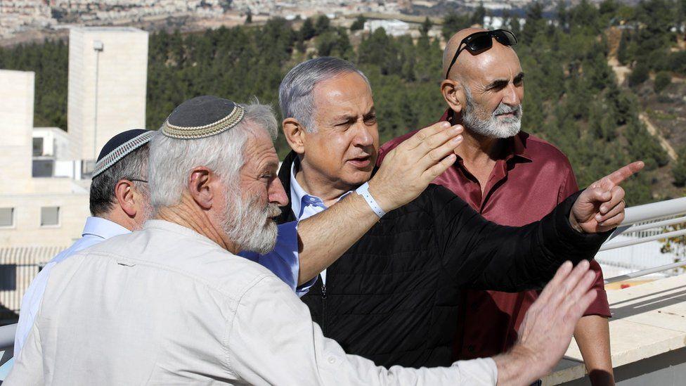 Israeli Prime Minister Benjamin Netanyahu (centre) meets Israeli settler leaders in Alon Shvut settlement, in the occupied West Bank, on 19 November 2019