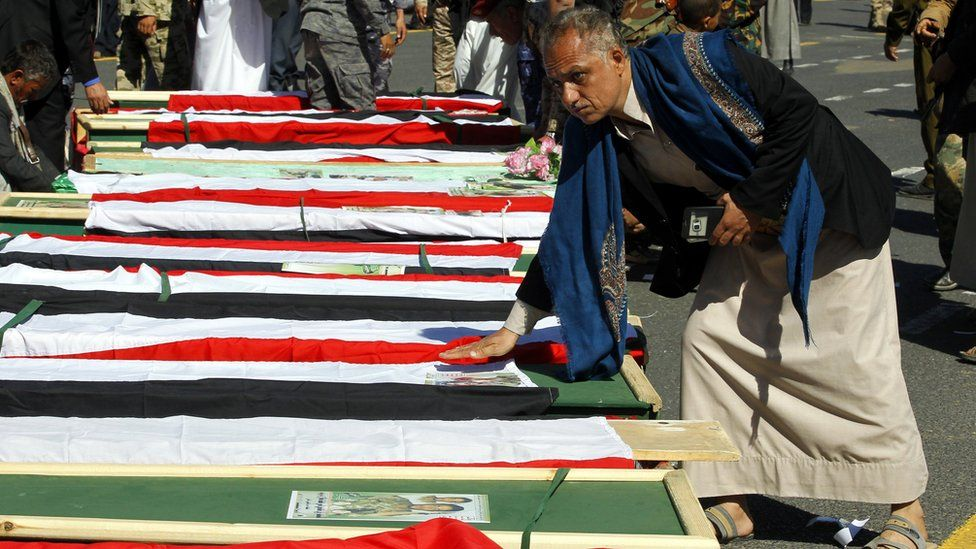 Houthi supporters gather around the coffins of Houthi fighters reportedly killed in recent clashes in Sanaa, Yemen (7 December 2017)
