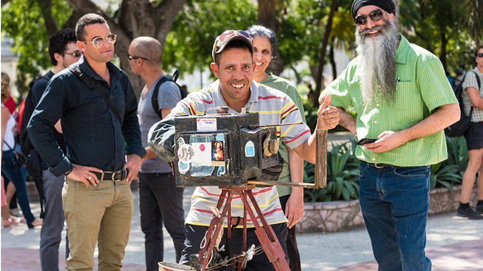 Man in Cuba with box camera