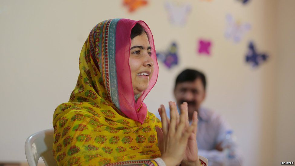 Nobel Peace Prize laureate Malala Yousafzai gestures inside a classroom at a school for Syrian refugee girls, built by the NGO Kayany Foundation, in Lebanon's Bekaa Valley July 12, 2015